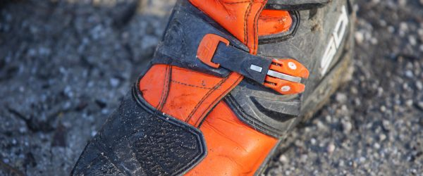 The foot has a little less plastic than high end MX boots.
